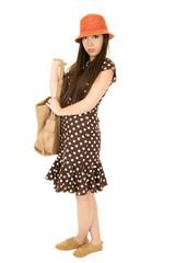 Young teen girl wearing an orange hat carrying purse