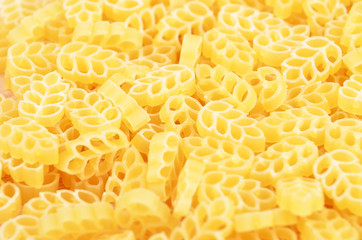 Close up of wheat shaped pasta as background