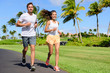Sport couple exercising running outside on street