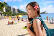 Asian tourist woman on Waikiki beach, Hawaii, USA