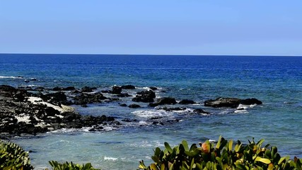 Gentle waves on the rocky shore