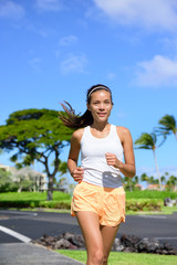 Young Asian mixed race woman jogging outside