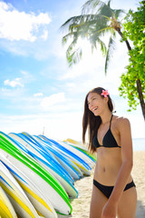 Bikini woman renting surfboard in Waikiki beach