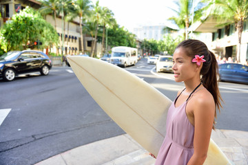 Urban surf - surfer girl going surfing in Waikiki