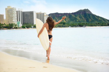 Happy lifestyle surf woman surfer in Waikiki beach