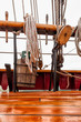 Leinwanddruck Bild - Close up detail of ropes, rigging, pulley on a big sailboat
