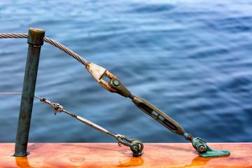 Sailboat railing hardware detail. At sea close up.