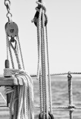Sailboat ropes, pulleys and rigging detail in monochrome