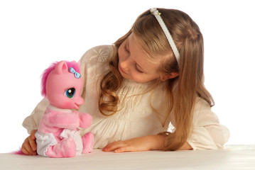 girl playing with her toy pony