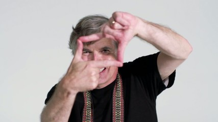 Male photographer frames a shot with his hands.