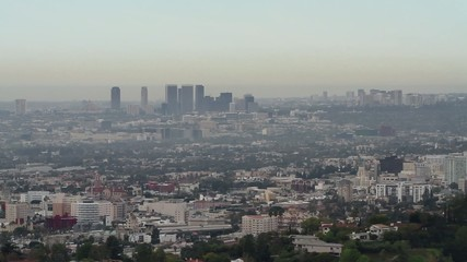 View of the cities of Los Angeles and Hollywood in the county of Los Angeles, California.  Freeway traffic visible and a plane, very small, can be seen flying over downtown LA.  Locked off camera. Two clips.