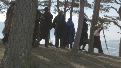 Fantasy Group walking on hill between trees