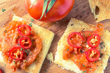 Toasts with roasted tomatoes