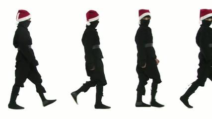Seven young ninja assassins in Santa hats walk through the shot.  Ho Ho Ho!  It's a full-length shot on a white background.
