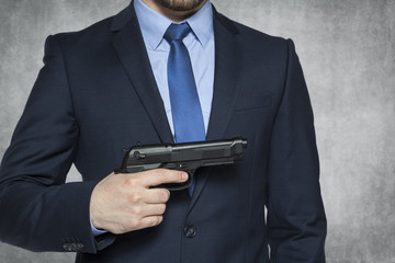 businessman holds a gun for self defense