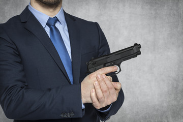 businessman presenting a weapon