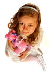 portrait of a girl with pink toy pony