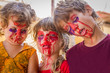 three young kids - boy and girl - with painted faces, child zomb
