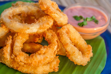 seafood snacks, calamaris, squid rings served in outdoor restaur