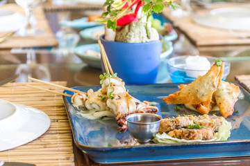 seafood snacks, calamaris, squid rings served in outdoor restaur