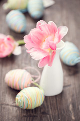 Easter photo decorated with colourful eggs and tulip