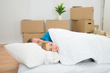 Young Couple Sleeping On Mattress
