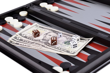 Dollar bills with dice on the   backgammon