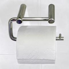 Toilet-paper on metal holder.
