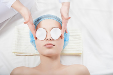 Woman getting face treatment in medical spa center