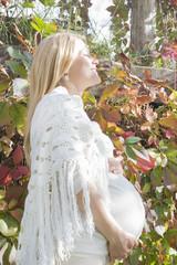 Beautiful pregnant woman enjoying a sunlight
