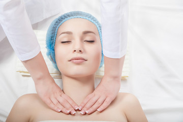 Beautiful young woman undergoing a massage