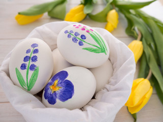 Painted Easter eggs in the linen bag