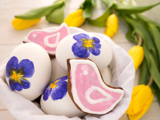 Painted Easter eggs and pink bird shaped cookies