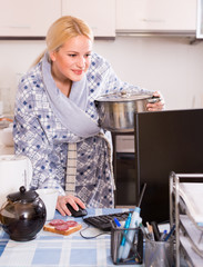 freelancer with dishware working on PC