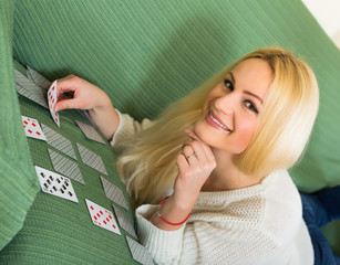 Woman playing solitaire on couch