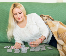 Housewife telling fortunes by cards