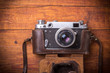 canvas print picture - Retro camera on wood table background, vintage color tone