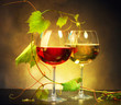 Two glasses of wine decorated with grape leaves - 80120213