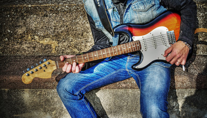 guitarist with a colorful guitar in hdr
