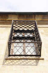 Old wooden window with grill