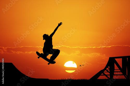 Fototapeta skateboard at sunset