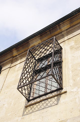 Old wooden window with wrought Iron