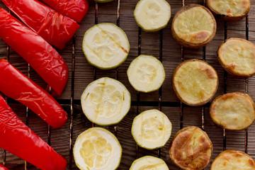 Рерреr, marrow, potatoes on grill