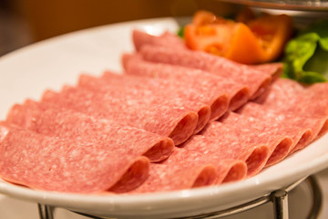 Sliced Salami on Plate