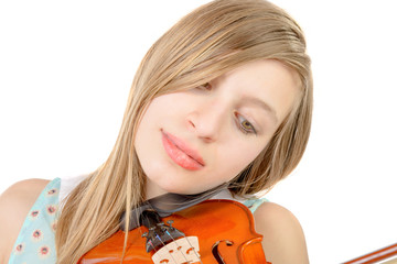 a teenage girl with long hair plays violin