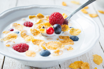 Cornflakes with berries for breakfast