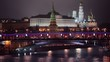 Traffic on bridge and quay near Kremlin at night in Moscow