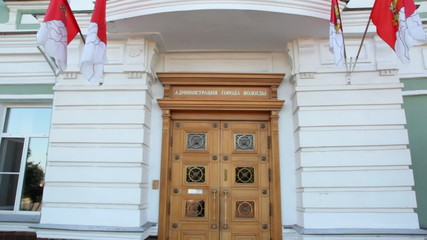doors with flags of building of city administration of Vologda