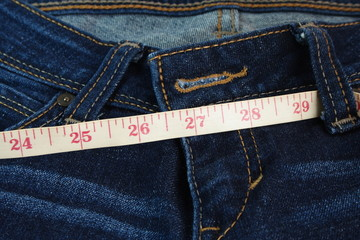 Jeans and measure tape