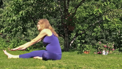 Pregnant woman yoga exercise during pregnancy outdoor at park